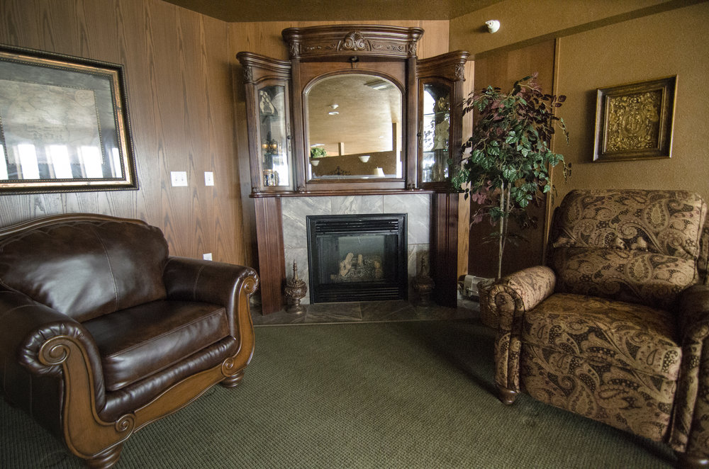 "Relax by the fireplace at ""The Club"" at Somerset Court - Minot"