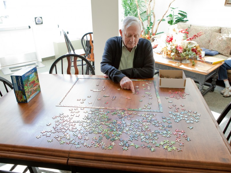 Working on a Puzzle in the Sun Room at Somerset Court - Rapid City