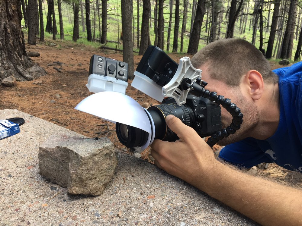 Chad photographing a jumping spider in the high elevation mixed conifer forest of Barfoot Park