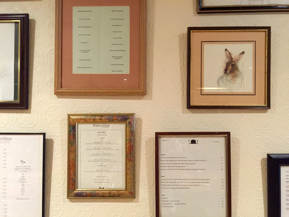 Menus in picture frames on the dining room wall - The Tame Hare