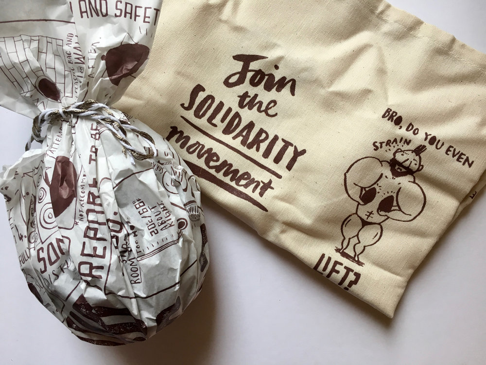 The Solid Egg wrapping and screen printed tea towel