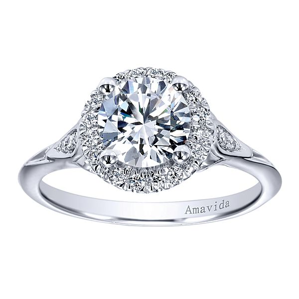 ER11921  – 1.00 CT Center Stone Set In 0.15 ct Setting In A 18K White Gold Band.  List Price: $1,340