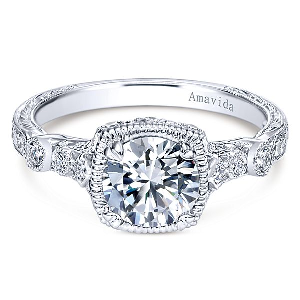 ER10053  – 1.00 CT Center Stone Set In A 0.21 ct Setting In A 18K White Gold Band.  List Price: $2,035    Our Price: $1,628