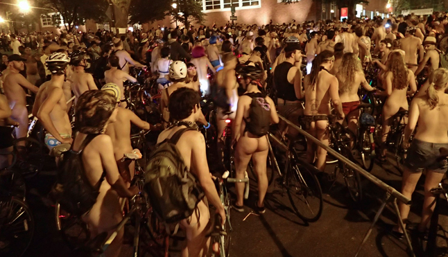 In the park blocks in front of the Portland Art Museum, more than 5,000 riders await the 10pm start of Portland's 10th-annual World Naked Bike Ride. (Christina Cooke)