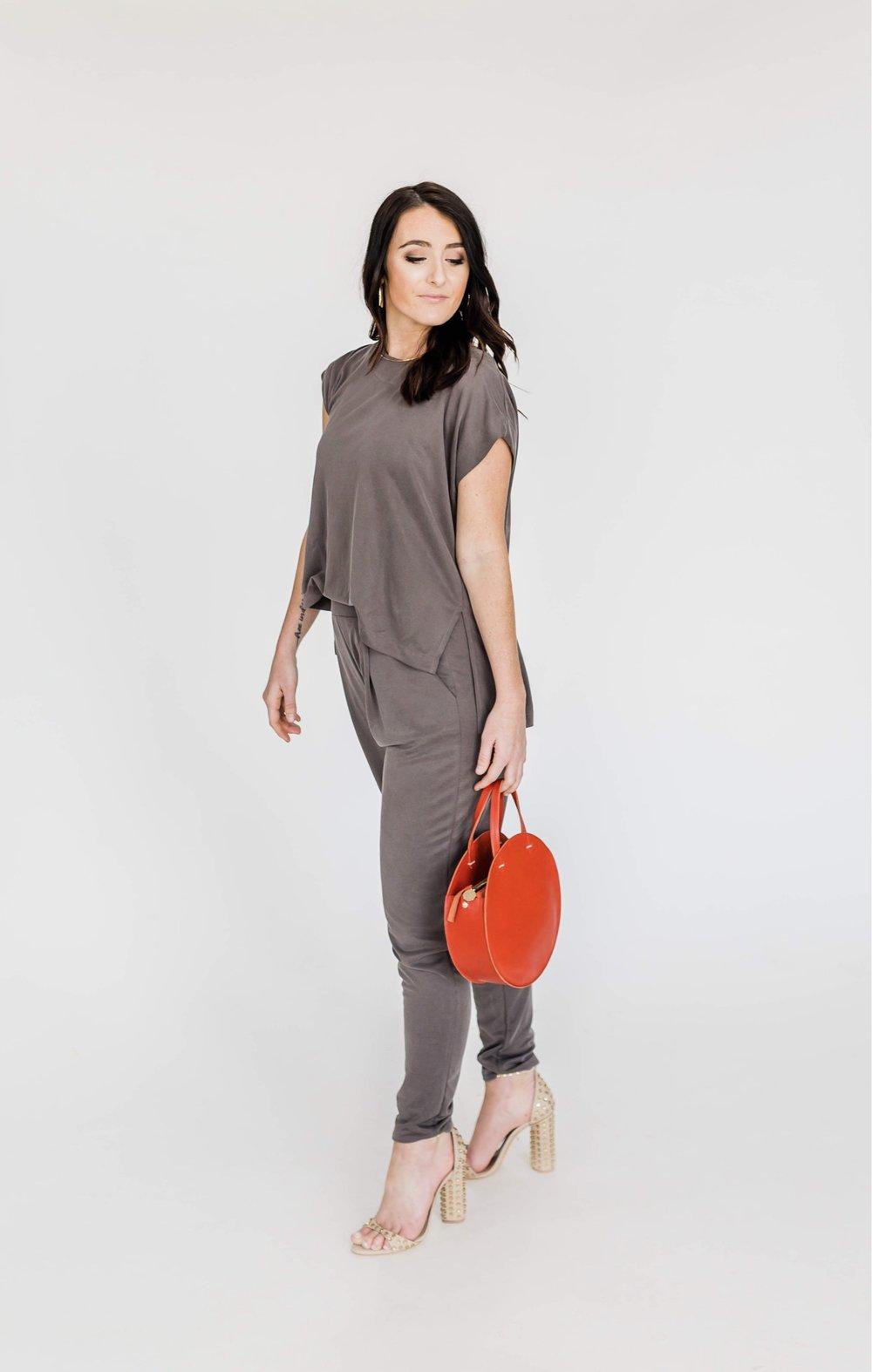 Kara's Look - What She's Wearing:Five & Two Gold HoopsFive & Two Rochelle NecklaceClare V HandbagSchutz Heels