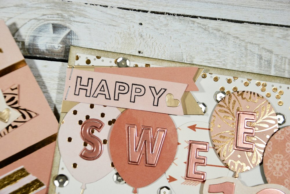 "The ""happy"" is stamped with Clearly Kelly Outline Letters and the back banner and heart are from the  Love Notes die set ."