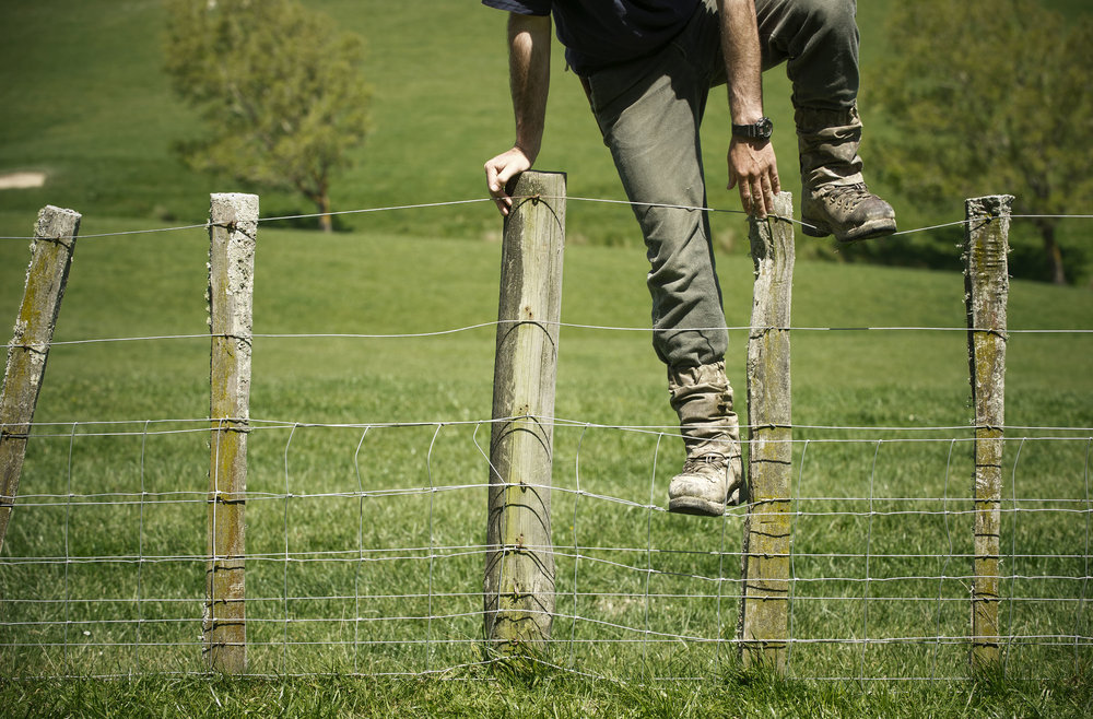 Farmer going over fence.jpg
