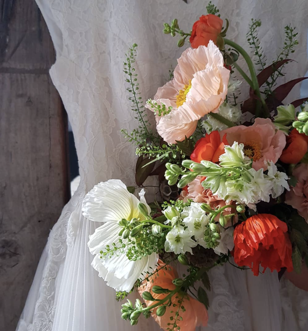 Seasonal bridal bouquet and wedding flowers