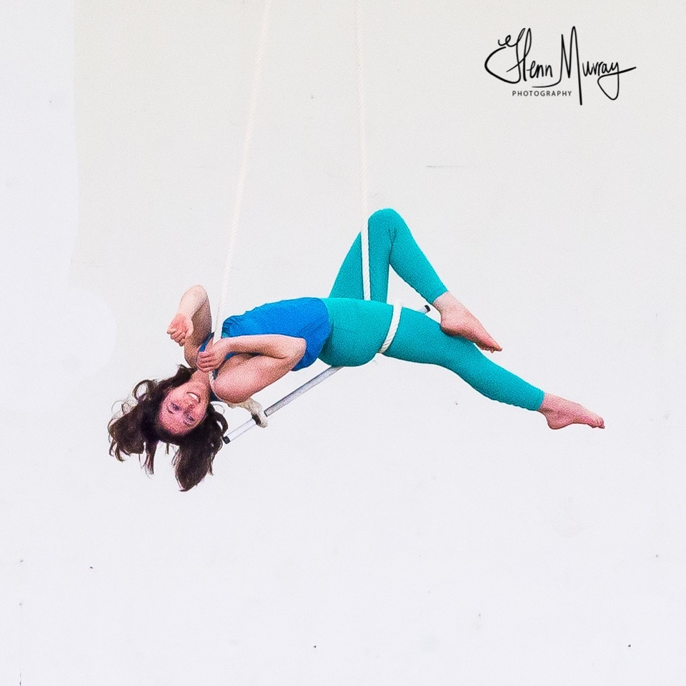 - Christina Vega-WesthoffA livelong mover, Nina Vega-Westhoff began modern dance, dance trapeze, and improvisation studies with ZUZI! Dance in 2008 and 2009 in Arizona, later expanding her aerial practice to include invented apparati, silks, static trapeze, lyra, rope, and sling. She has taught movement, aerial arts, and writing in Spanish and English in Mexico, the U.S., and Panama to students of all ages and was a primary instructor at Buffalo Aerial Dance from 2015-2016. Nina's movement studies include certifications in Hatha Yoga (2013), MomentOm Arts Aerial Yoga (2014), Nimble Arts' Intro to Aerial Arts (2016), and Adult & Pediatric CPR/First Aid/AED; intensives in Luigi Jazz Dance, yoga therapy, Skinner Releasing, modern, improvisation, aerial dance, and site-specific performance; and classes in many movement styles. She has performed and/or choreographed for New Phoenix Theatre's Pinocchio, Monica Harvey's While Moving on Purpose, Stanzi Voubel's Unknowable Worlds and Indeterminacy Festival, Project Grant's 48 Hours: Seeds, the Contemporary Circus Arts Festival of Toronto's Creation Relay, O-T-O's Migrations, solo works, and various shows with ZUZI! Dance, Katherine Tesch, Buffalo Aerial Dance, The Bird's Nest, Canopy Arts, and more.