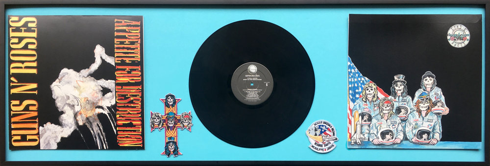 Appetite For Destruction Challenger Disaster Edition  Photograph, material, patches, cardboard, glue, video, picture frame, record. 45 x 15 inches (framed). 2018