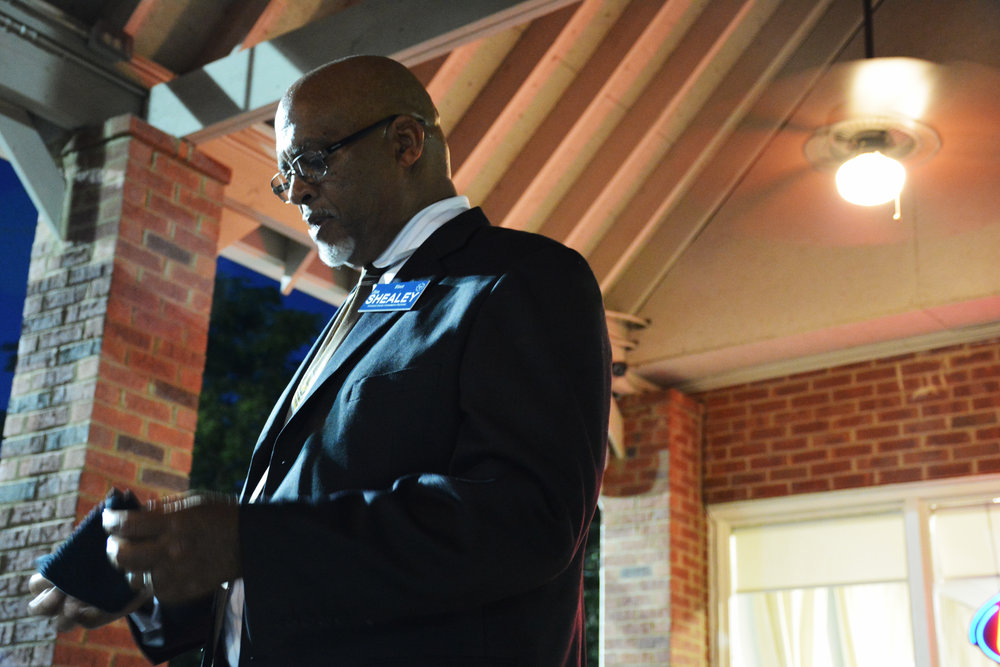 Democrat Jim Shealey pauses while addressing voters at a fundraiser in Norcross, Georgia on a muggy late-summer evening. He's running to become the county's first African-American elected official.