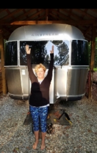Martha in Hastasana:) in front of the 31 ' Airstream