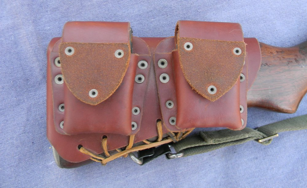 load bearing harness. - Carry two rations, for that surprise overnighter. A practiced rifleman will feel right at home behind a rifle carrying Stock Pocket. The pouches are balanced and easy to use. The full wrap leather harness keeps the low slung pouches stable on the rifle.