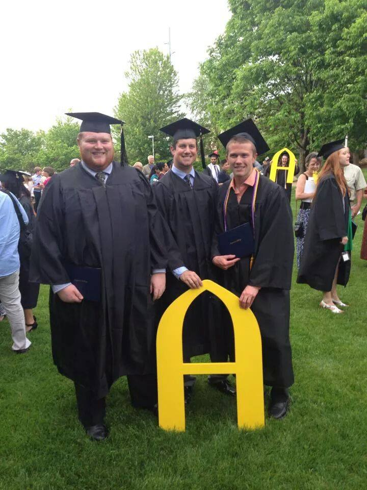Pictured, my two cousins and a beached whale, graduating at 350 lb