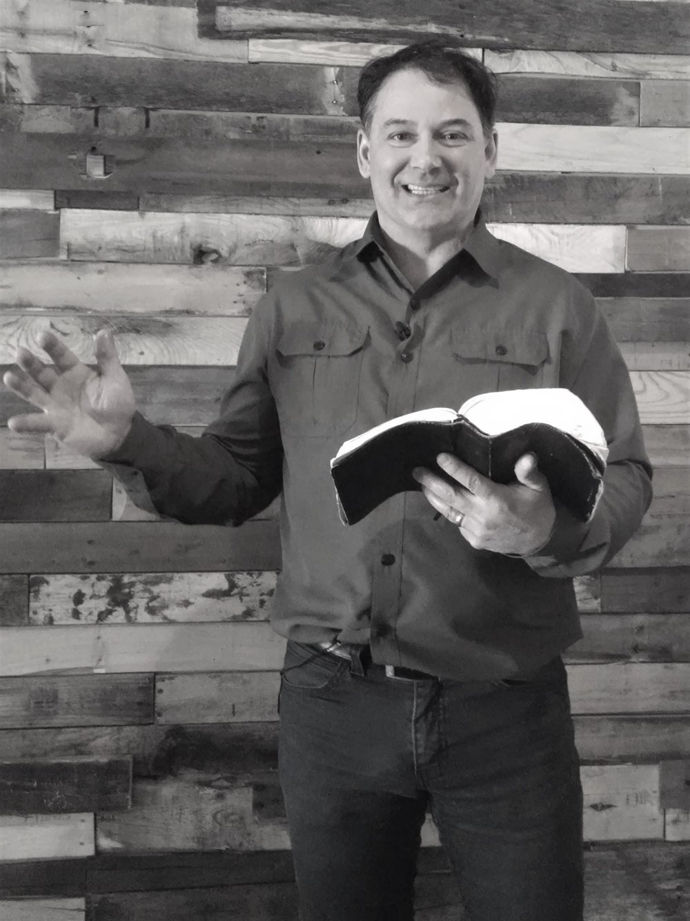 Doug with bible bw.jpg