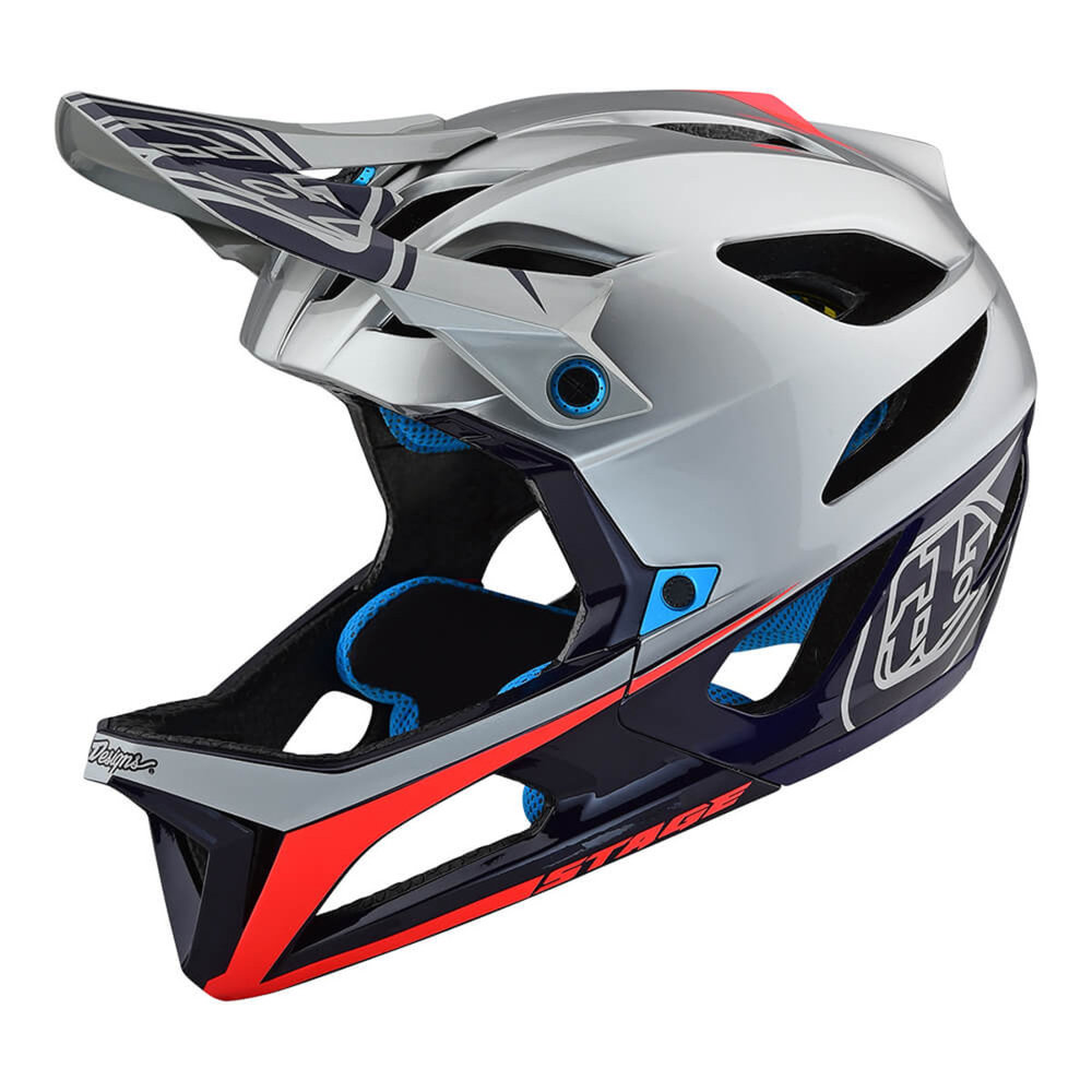 Troy Lee STAGE RACE HELMET  As a pioneer in helmet design and styling, Troy Lee has never been afraid to cross genres. Now TLD blazes another trail with its all-new Stage helmet – a full-face enduro/trail MTB helmet that slots in between the D3 and A2 designs. Featuring a class-leading 675 gram weight, the Stage design sources a Polylite shell with fiber reinforcement and Polyacrylite injected chinbar. Dual-density EPS and EPP foam offers protection against high- and low-speed impacts, while the innovative MIPS (Multi-directional Impact Protection System) brings cutting-edge safety technology. 11 high-flow intake ports channeling out 14 exhaust vents, and a comfort liner comprised of odor-fighting silver X-static® fabric keep your head cool in the heat of battle. It's a versatile design that is ideally suited to trail riding. Add in the intangible allure of TLD styling and the Stage helmet is one of the most exciting and coveted new products of the year.