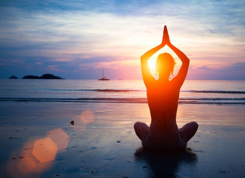 yoga asana beach.jpeg