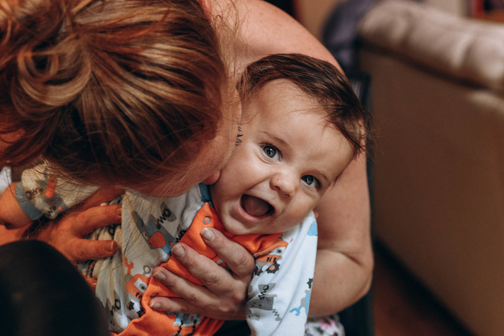 Jennifer_Kissing_Baby_Postpartum.jpg