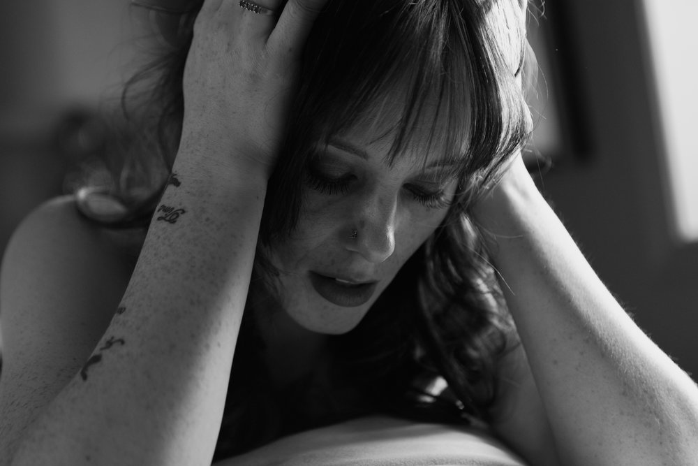 Woman looking down during boudoir session in Helena Montana by boudoir photographer Misty Boles
