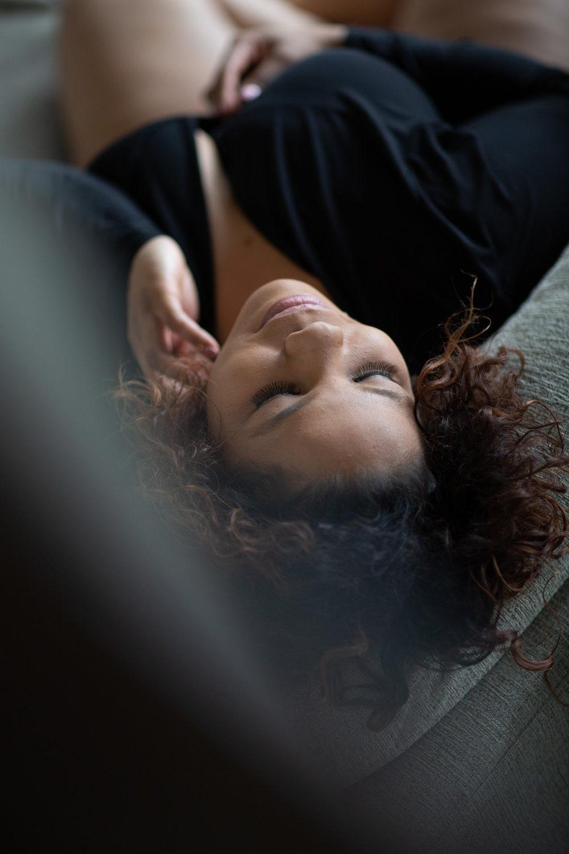 Woman in black bodysuit. Boudoir session in Helena, Montana by boudoir photographer Misty Boles