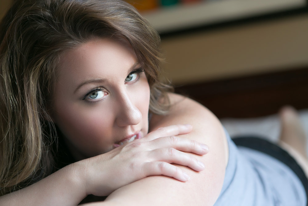 Woman staring at camera. Boudoir session in Helena, Montana by boudoir photographer Misty Boles