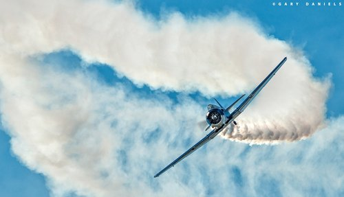 Steve Afeman   Steve performs a solo aerobatic act in his North American T-6 Texan.