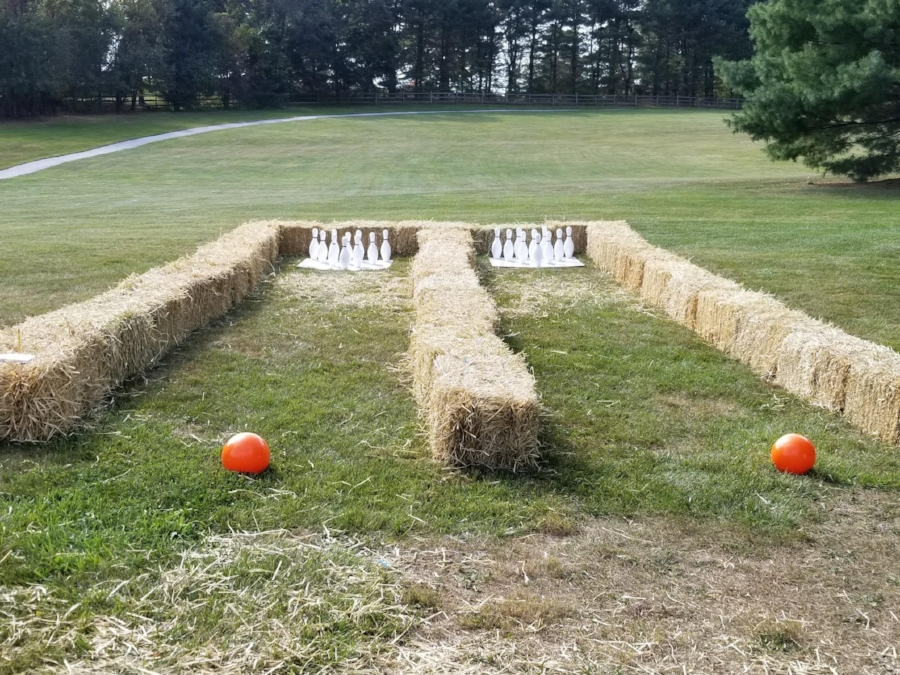 Lawn Bowling - We'll provide the bowling balls, bowling pins and hay bales, your provide the guests!  This is a perfect touch for an outdoor corporate employee appreciation day along with scarecrow making stations for a truly fun Fall festival feel!