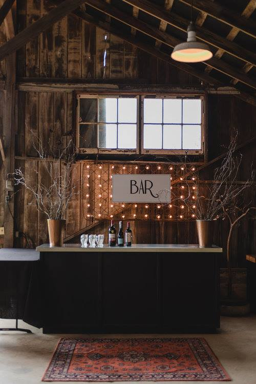 the bar, with our custom antique metal mattress sign