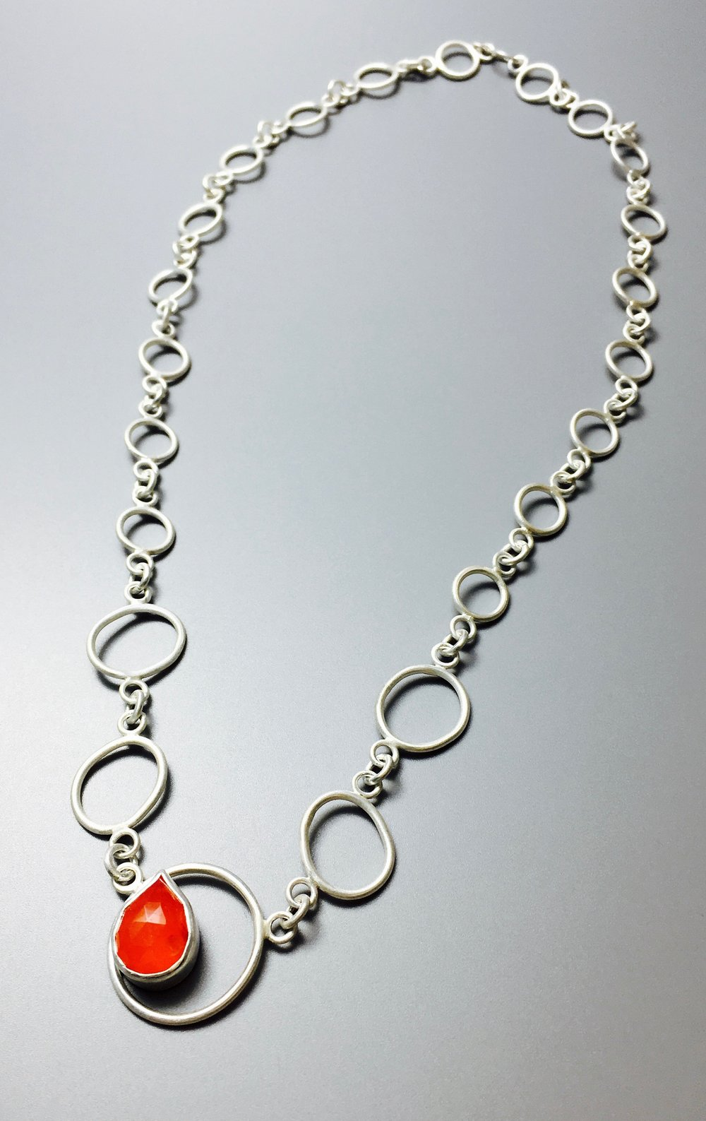 Bubble-chain & faceted pear-shaped carnelian