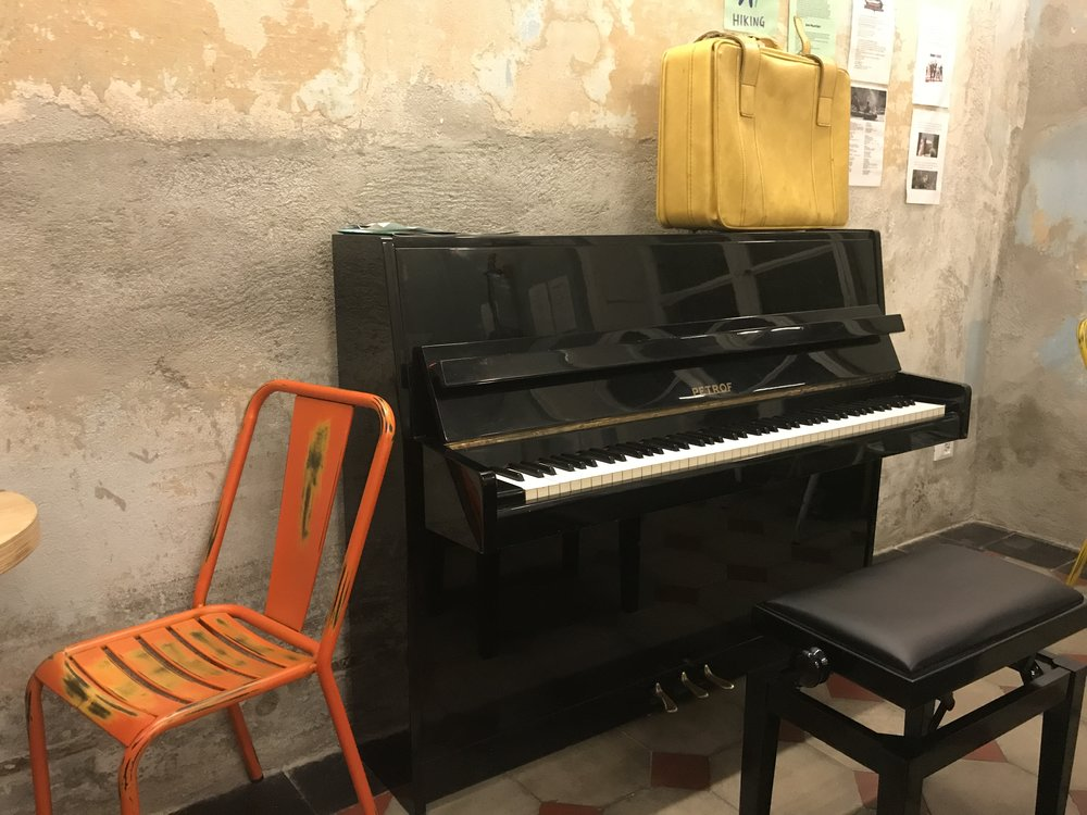 The piano in the common area of Ostello Bello, Lake Como.