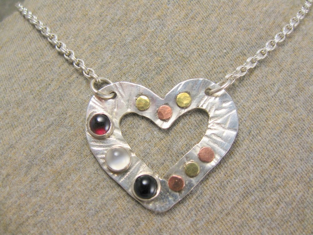multi surface heart necklace