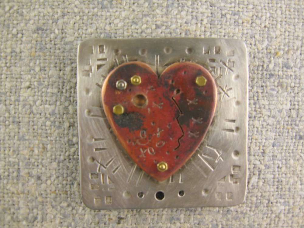 marked heart pin