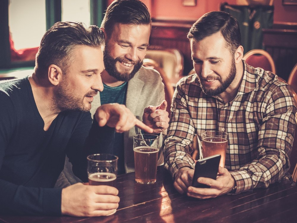 cheerful-old-friends-having-fun-with-smartphone-P2Q2NTC.jpg
