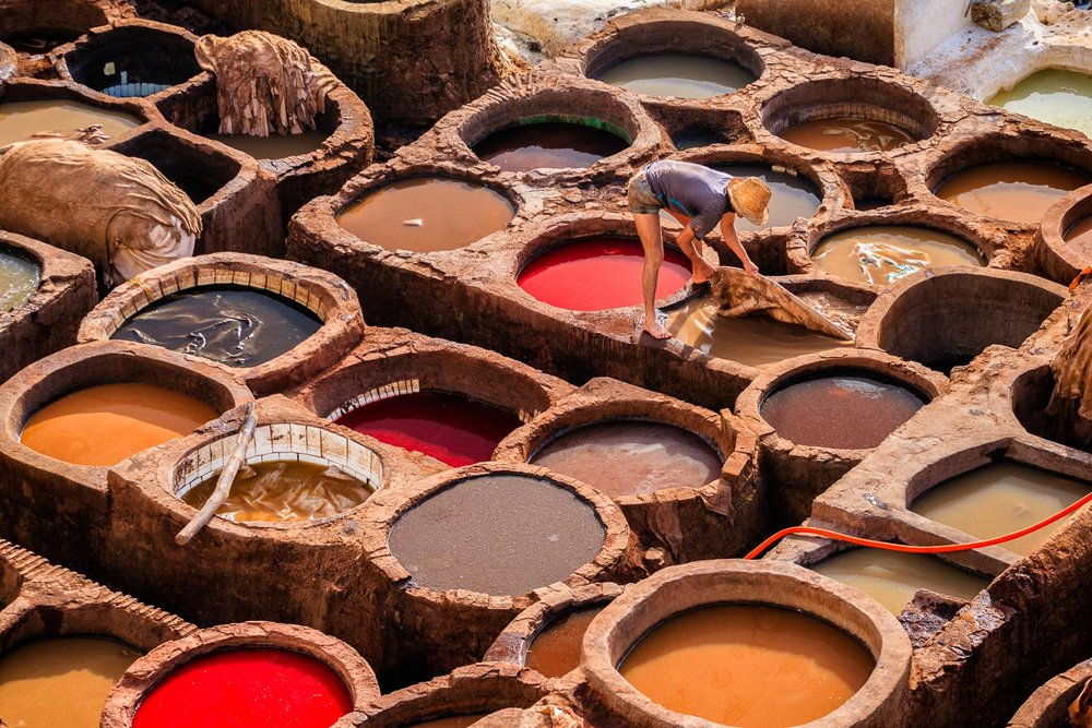 Man working tannery, Fez, Morocco. Image credit: Bartosz Hadyniak/Getty Images