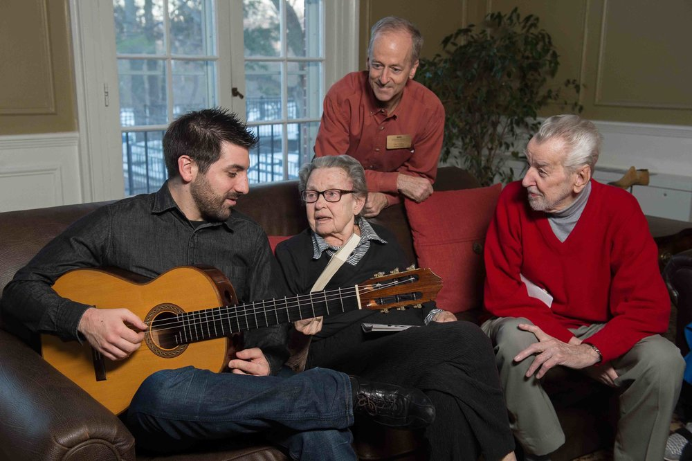 Julien Xuereb (Peabody MM '15, Guitar Pedagogy) spearheaded the Musician-In-Residence program, now part of the work of the Johns Hopkins Center for Music and Medicine in examining the role of music in improving the lives of patients and caregivers. Image credit: Homewood Photography