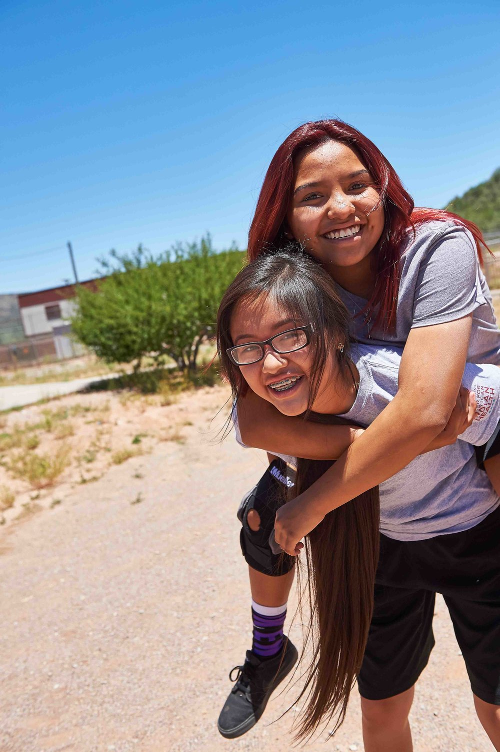 Female participants connect during an adolescent health program in Whiteriver, AZ/Fort Apache in 2016. Photo credit: Ed Cunicelli