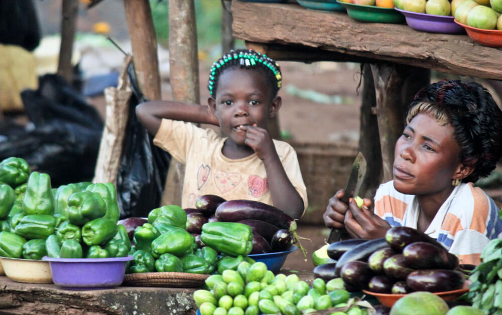 A mother and child sell vegetables at a roadside stand in Kampala, Uganda. Credit: ©2011 Rachel Steckelberg, Courtesy of Photoshare