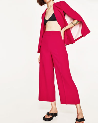 Pair Zara's high waist trousers in red or yellow with a crop top for the ultimate retro girl vibe.