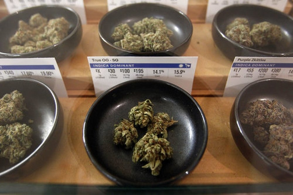 Different types of marijuana sit on display at Harborside marijuana dispensary on Jan. 1, 2018, in Oakland, Calif. (Mathew Sumner/AP)