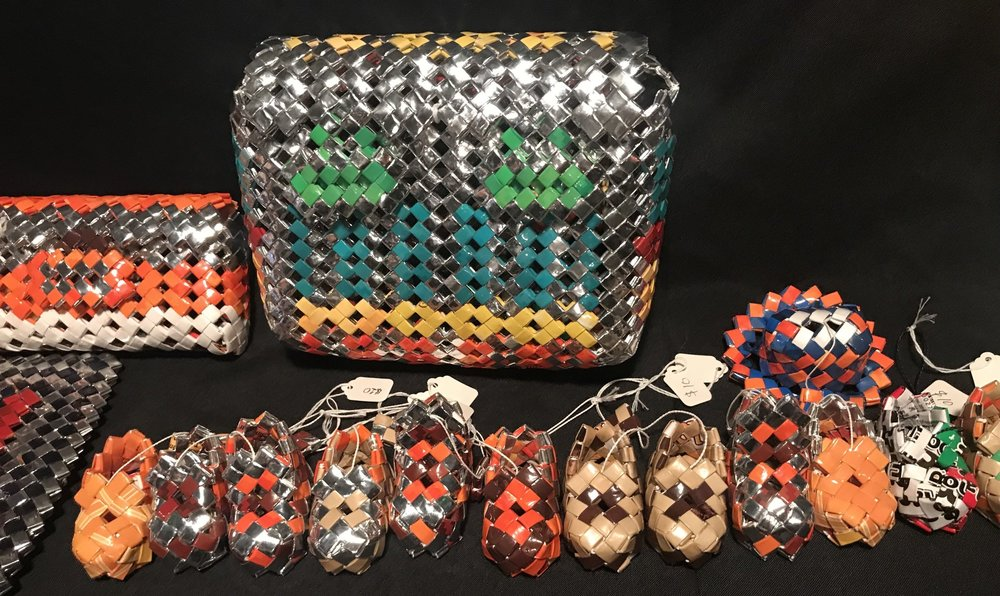 SHOEB'S UPCYCLED WEAVE DESIGNS - Shoeb creates and sells beautiful Bangladeshi inspired woven pieces from upcycled plastic.He repurposes them into artistic bags,  boxes and other forms.