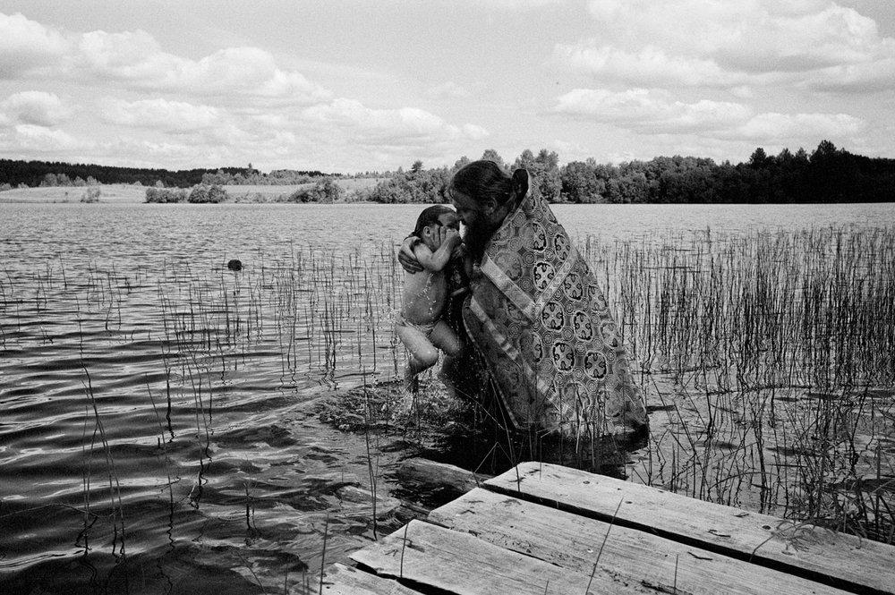 THE PRIEST ARKADIY BY BAPTIZINGKolodozero, Karelia, Summer  2014
