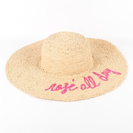 """Our ""liquid aloha"" will transport you to paradise—and now you can look the part! The cutest way to show off your love of rosé is with this darling  straw sun hat  from Hat Attack, which  I've been happily rocking  all year.""    Rosé All Day Sun Hat  from Hat Attack"