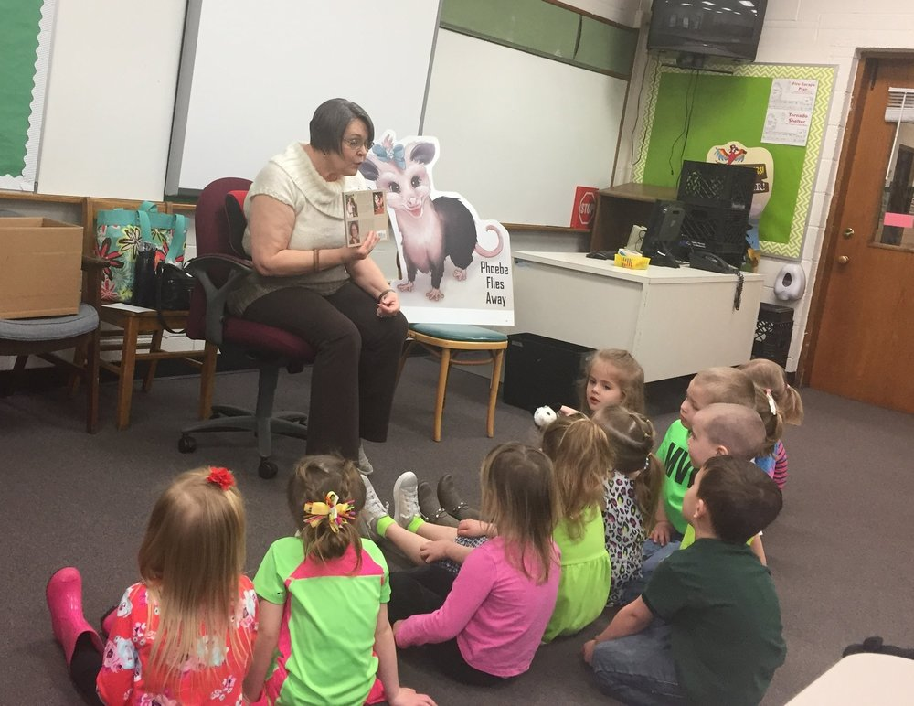Co-Author Miriam Hulett of Phoebe Flies Away reading to children.JPG
