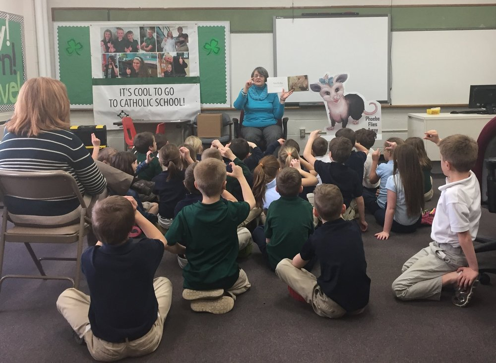 Childrens Book Co-Author Miriam Hulett Reads Phoebe Flies Away to Classroom of Children.JPG