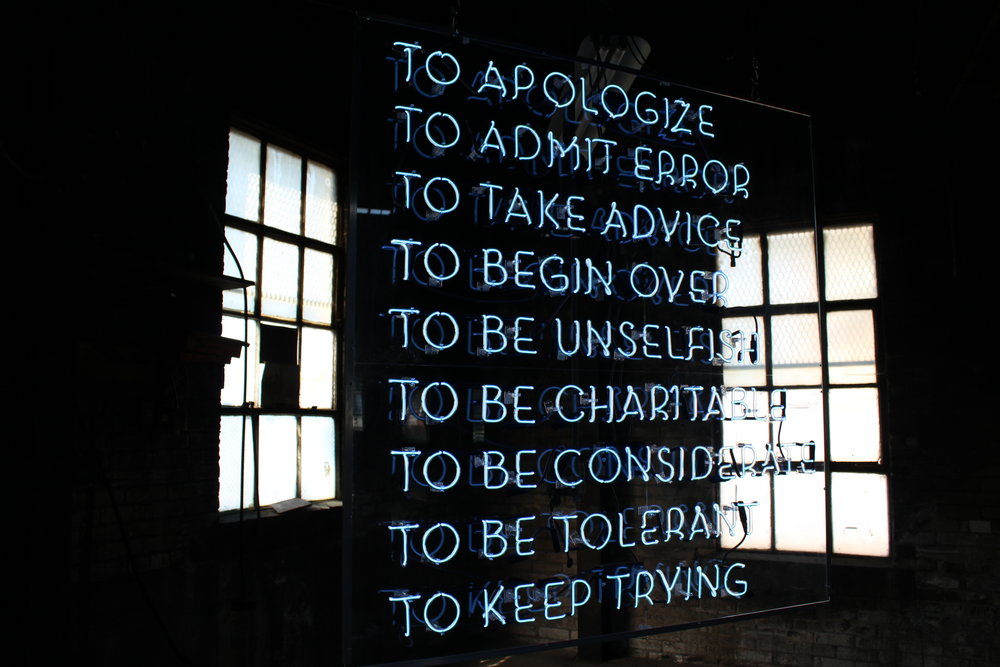 "Neon piece, ""Infinitive"" by Helen Lee echoed one of many bits of humor and wisdom workers pinned on the wall of the foundry office. Fabrication by Tom Zickuhr and Ben Orozco."