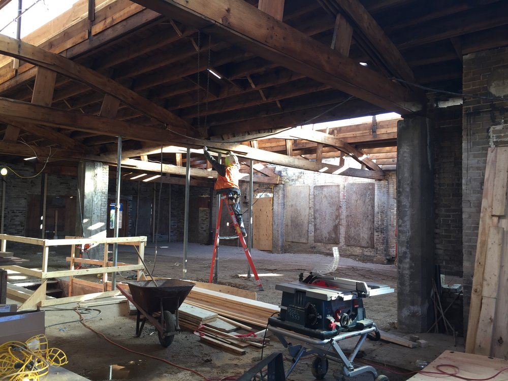 In this photo a construction team member is working on restoring the historic structure.
