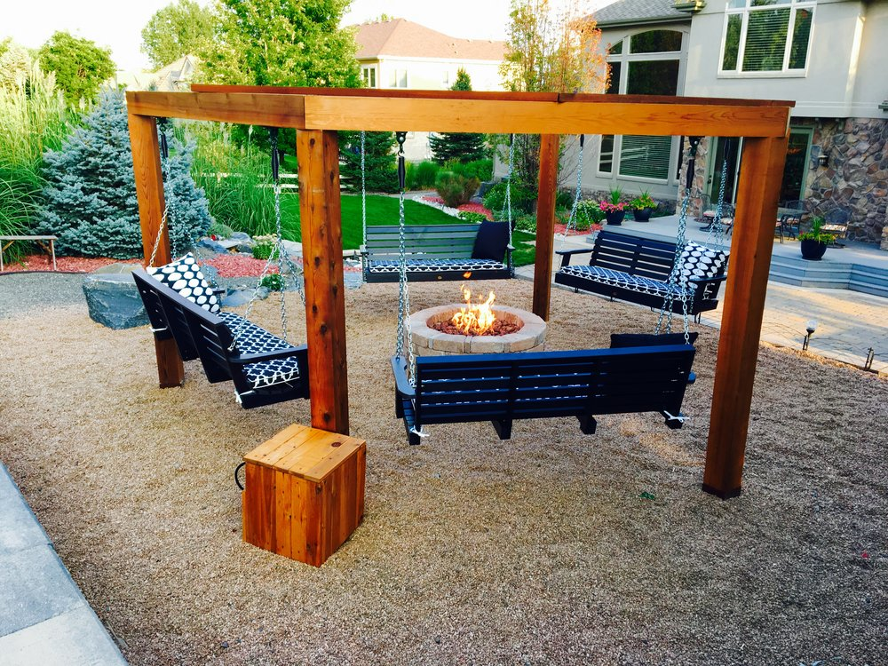 Hexa-Lounge and custom propane fire pit in Arvada, CO  We used 6x6 Cedar posts and beams to create a comfortable, six sided swing stand. The space was finished with a Pavestone fire pit, Warming Trends 180k BTU burner attached to a propane tank, and a custom, Cedar propane tank hideaway.