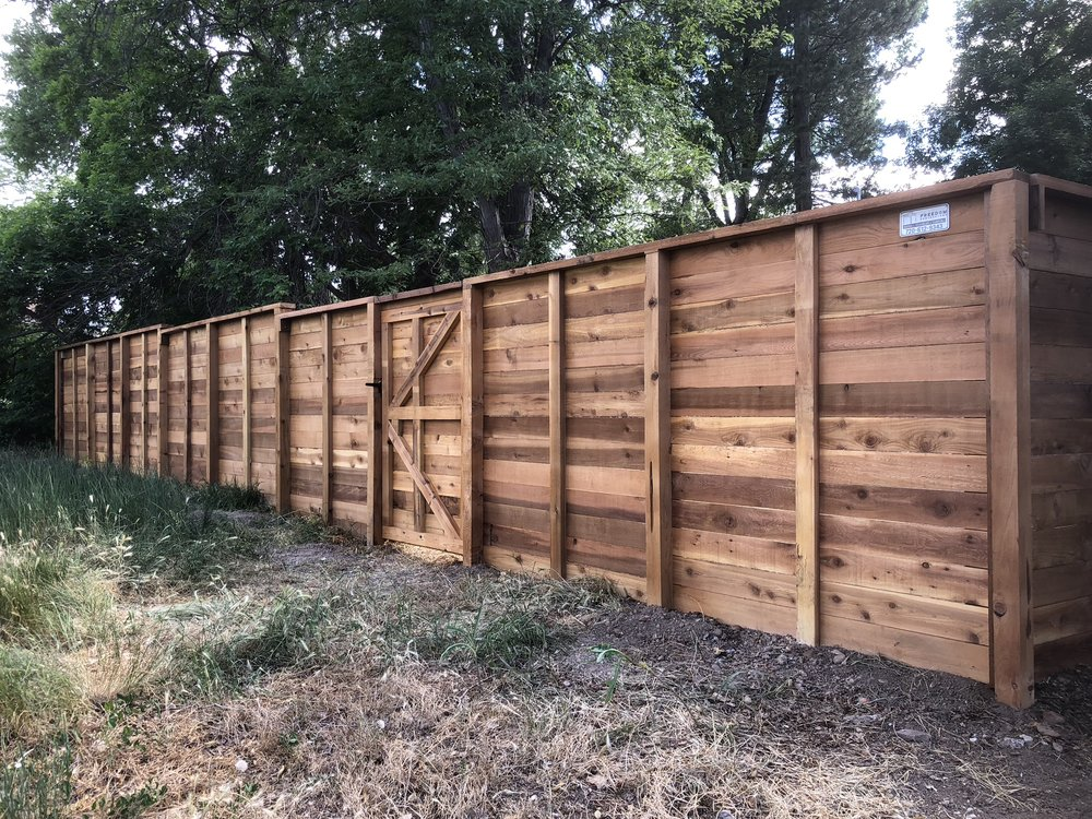 horizontal fence in denver, co  This beautiful horizontal fence was constructed to add privacy, security, and aesthetic value to this customer's home.