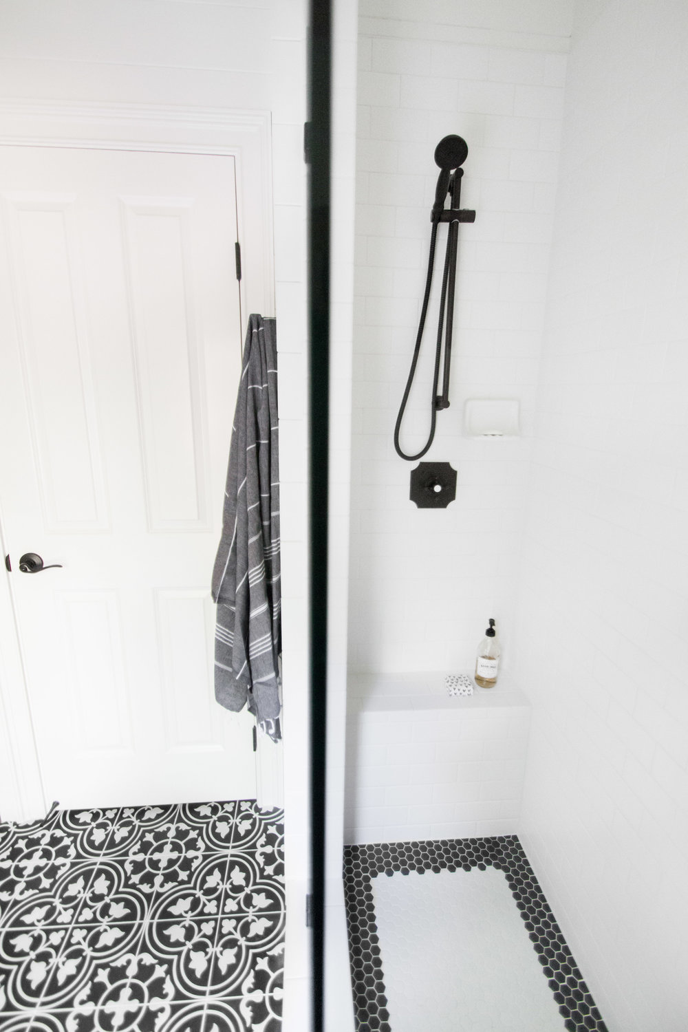 bathroom with black and white tile