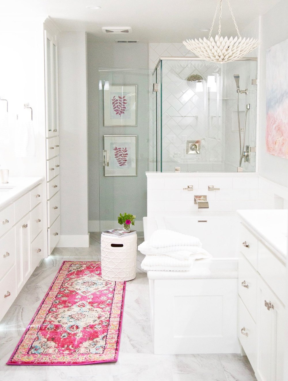 bathroom with white cabinets